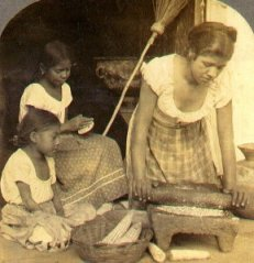 Traditional tortilla making. The mother grinds the maize with a stone mano and metate as the elder daughter pats the dough into tortillas.  (, c. )
