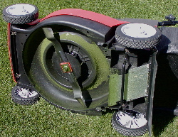 Underneath electric mower, showing mulching blade