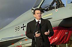 "Chancellor  with a new Luftwaffe  Typhoon. The name ""Typhoon"" caused controversy since the  was an RAF ground-attack aircraft which destroyed many targets in support of the ground forces invading France in June 1944 and afterwards"