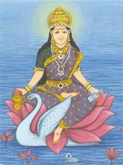 Goddess Gayatri, holding a book in one hand and a cure in the other, sitting on a lotus flower and accompanied by a swan