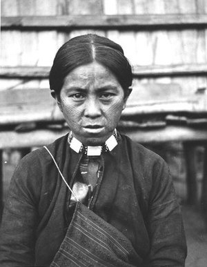 An  tribal lady with tattoo on her face as a symbol of maturity, which was a tradition for both males and females. The custom was prohibited by the authority during the Japanese rule.
