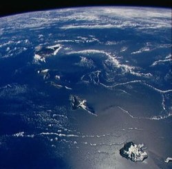 Photograph of the Hawaiian Islands from , looking southeast by south. Kaua'i is closest at bottom right