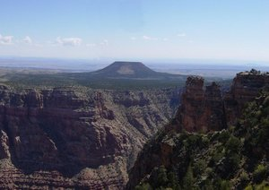 Cedar Mountain is a mesa made of the Mesozoic-aged Moenkopi Formation.