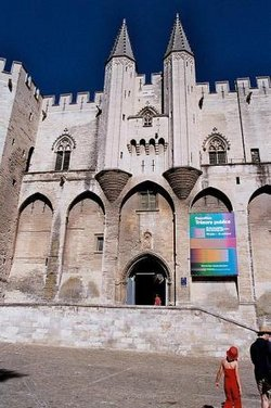 The  was the seat of the Papal Curia. When the popes resided here at Avignon, it was an  within French territory.