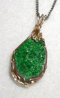 Pendant in uvarovite, a rare bright-green garnet. The long dimension is 2 cm (0.8 inch)
